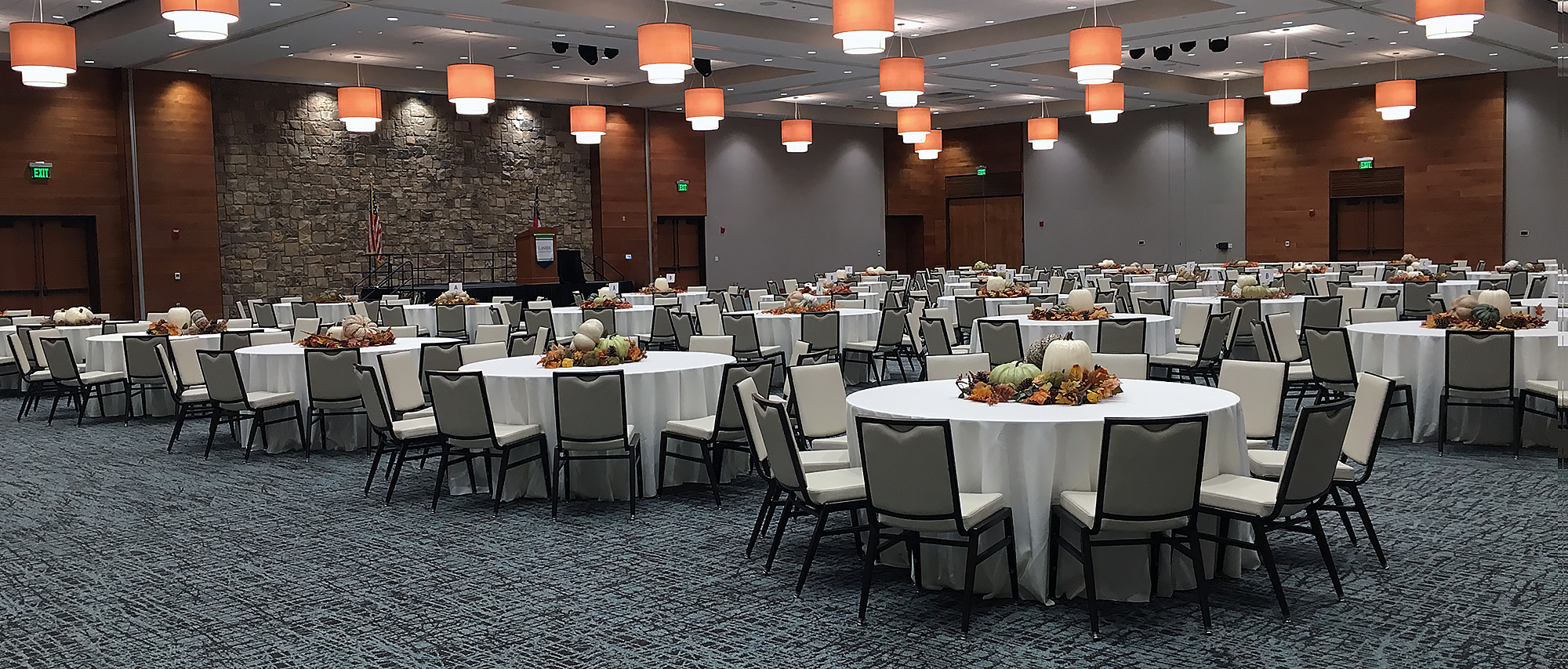 Conference Center setup with fall decor on round tables